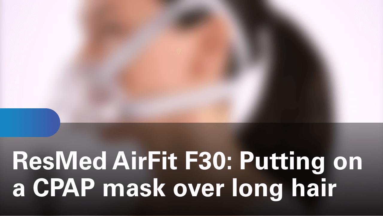 sleep-apnea-airfit-f30-putting-on-a-cpap-mask-over-long-hair