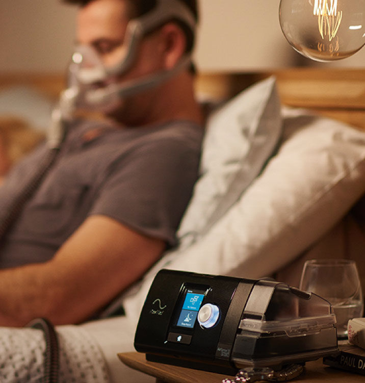 sleep-apnea-replacement-parts-airsense10-man-wearing-full-face-mask-in-bed